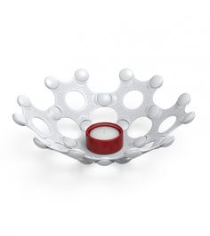 No matter where in the world you are, for us candle light is part of the Christmas spirit. This white and red eco-friendly tea candle holder is great!