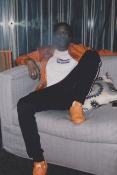 ASAP Rocky wearing  Adidas x Raf Simons Stan Smith sneakers, Supreme Box Logo Tee, Adidas Cuffed Tapered Tracksuit  Bottoms