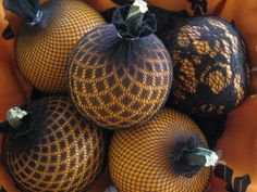 Fishnet stockings over pumpkins