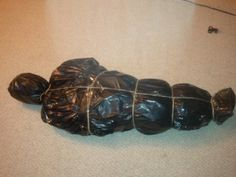 DIY Halloween Dead Body... My first try.... Super easy... It's amazing what you can do with some trash bags, newspaper and twine.