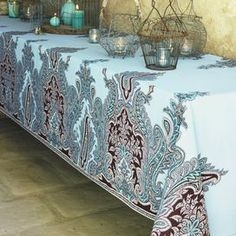 Cotton tablecloth with a turquoise paisley motif.   Product: TableclothConstruction Material: CottonColor: TurquoiseFeatures:  Ornate designUncoated Dimensions: 70 Diameter Note: Picture is indicative of the design. Actual tablecloth is round. Cleaning and Care: Machine wash warm, line dry