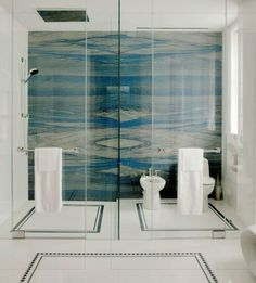 Azzurro Onda Marina granite wall in a luxurious bathroom -- turquoise, aqua & off-white stone -- image cropped from Interiors, August/September 2011, pages 68-69: http://www.interiorsdigital.com/interiors/20110809#pg69 -- photo: Tim Street-Porter -- designer: Juan Montoya