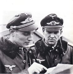 Two of Germany's Top Aces: 653 Victories between them. Hauptmann Erich Hartmann and Major Gerhard Barkhorn. Hungary, 1944.