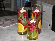 DIY Christmas floating candle centerpieces, made with cranberries, orange slices and twigs from Christmas tree, love this!