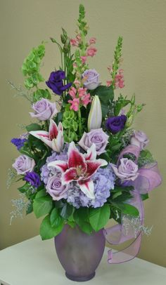 Lavender and purple flowers by Willow Branch Florist of Riverside