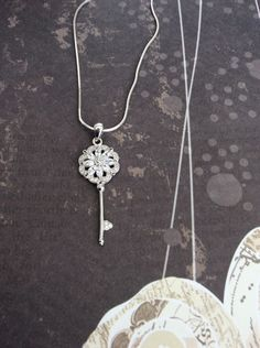 Sterling Silver Key Pendant-Sterling Silver Layering Necklace. by Jewelriart on Etsy https://www.etsy.com/listing/225877947/sterling-silver-key-pendant-sterling