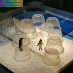 Penguin Small World Play on the Light Table. The sensory tray from Reflections sits within the rim of the lightbox. If water is used, the lightbox should be enclosed in a clear leaf bag, for safety. www.reflectionsli...