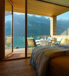 The Wohnhaus Am Walensee project was designed by the Austrian studio K_M Architektur. The house was completed in 2007 and is located in Unterterzen, a small Wooden House Design, Sweet Home, Dream Bedroom, Master Bedroom, Wood Bedroom, Design Bedroom, Eaves Bedroom, Night Bedroom, Nature Bedroom