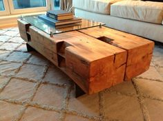 So awesome. Reclaimed beam and raised glass coffee table.  http://rebarn.ca/twin-barn-beam-coffee-table/