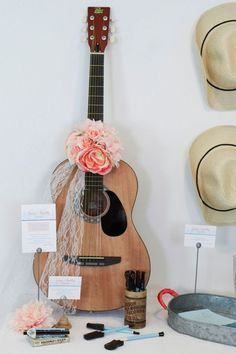 These pretty wedding decor ideas are inspired by Nashville country music. Get all of the musical guest book, table setting, cocktail, seating chart ideas and more now at fernandmaple.com!