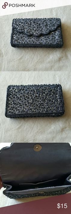 Beautiful beaded clutch Silver/gray beaded clutch. Perfect for prom or a night out! Great condition Bags Clutches & Wristlets