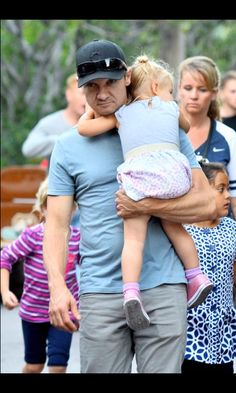 Jeremy Renner and daughter Ava in his arms. Can this day get any better. Oh wait it can because it's Jeremy Renner.