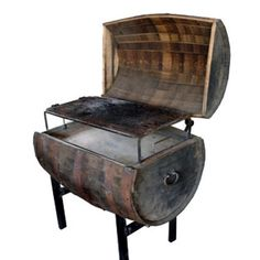 A whiskey barrel converted into a BBQ pit.