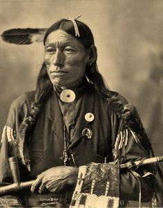 Little Bird - Arapaho - 1898. One can see what looks like a political button on his lapel, interesting. Perhaps President McKinley?