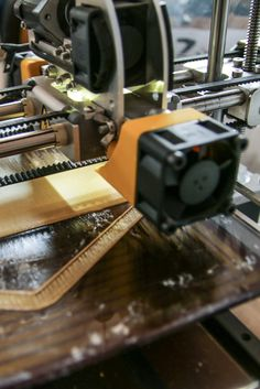3D printed parts include shelves, counterweights, a planetary gear mechanism, and the wall mounting.