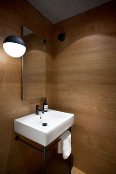 Interior Design by Falken Reynolds - Vancouver loft powder room with medium stained white oak floor and walls with Flos string pendant, photo by Ema Peter Vancouver, Basement Bathroom, Small Bathroom, Downstairs Toilet, Wooden Bathroom, Washroom, Loft Style Apartments, Modern Powder Rooms, Modern Loft