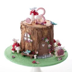 A cute little fairy cake for a little girls Birthday. All details edible and. A cute little fairy cake for a little girls Birthday. All details edible and the log made of te Fairy House Cake, Fairy Garden Cake, Garden Cakes, Fairy Cakes, Fairy Birthday Cake, Girls 3rd Birthday, 3rd Birthday Cakes, Little Girl Birthday Cakes, Woodland Fairy Cake