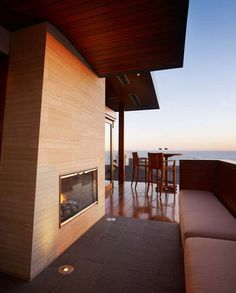 outdoor fireplace, built-in couch and the beach