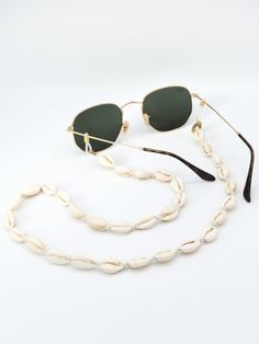 Sunnycords® are modern eyewear chains for your sunglasses. The Sunnycord® is a fashionable glasses cord for holding any kind of eyewear. Initially designed to never lose you glasses or reading glasses again. Shop your sunglass chain now online! Tom Ford Sunglasses, Cat Eye Sunglasses, Round Sunglasses, Reading Glasses, Sunglasses Accessories, Eyeglasses, Eyewear, Shells, Chain