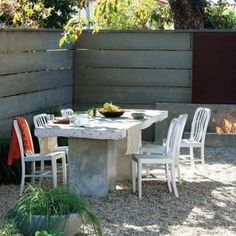 This outdoor dining table was given an industrial upgrade with a tabletop made of solid concrete, salvaged from a garden remodel. The table required two car jacks in order to be built, but recycling the concrete was an inexpensive makeover for Los Angeles designer Steve Siegrist (stevesiegristdesign.com).  Cost: Free--salvaged during a garden remodel Photo: Jennifer Cheung, Sunset.com