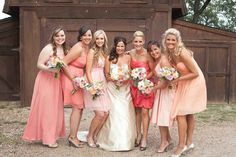 bridesmaids in shades of peach and coral