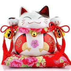 Chú Mèo MANEKI NEKO Biểu Tượng May Mắn Của Nhật Bản
