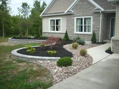 New Retaining wall & landscape.  The lawn will turn green, the plants will grow...the design has character.