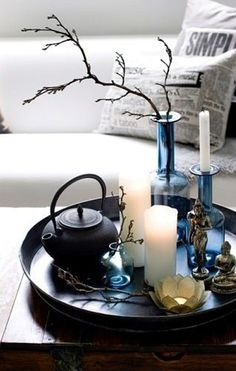zen coffee table arrangement // lotus, candles, a traditional pot