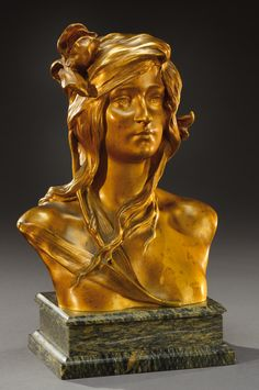 MAURICE BOUVAL A gold patina bronze bust of a young woman. Signed «M.Bouval» foundry stamp Colin. Cast circa 1900. H : 7 ¾ in (without base)
