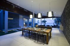 Hotels & Resort, Adorable Beach Villa Interior Design With White Large Tile Marble In Dining Space Lighted Pendant Plus Ceiling Lamp Stone Porcelain Wall Decor Awesome Beach Atmos: Beach Villa Design in Open and Natural Concept besides Sea Panorama