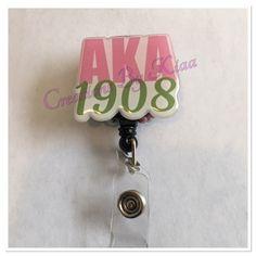 Excited to share this item from my #etsy shop: AKA Badge Reel- Sorority GIfts #sororityitems #pinkandgreen #akabadgereel #skeewee #akagifts #badgereel #pinkiesup #blingbadgereels #glambadgereels Mermaid Ornament, Custom Badges, Black Mermaid, Nurse Badge, Sorority Gifts, Badge Reel, Nurse Gifts, Pink And Green, Belly Button Rings