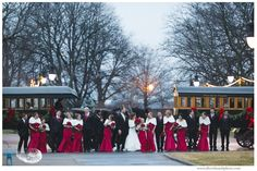 Greenfield Village's trees & horse drawn carriages created a stunning backdrop for this winter wedding's bridal party.