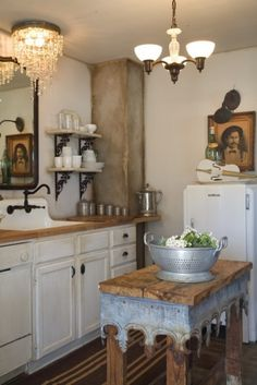Houzz via La Maison Boheme. lOvE the lighting, island, the violin and painting on top of the refrigerator. Pretty , pretty kitchen.