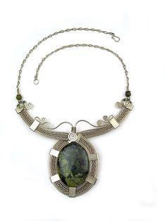 """Wire Wrap Necklace """"Cross Paradise."""" Hammered silver wire wrap necklace with eye-catching green serpentine stone makes a true fashion statement."""