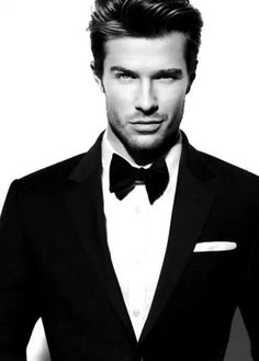 You could never go wrong with a well fitted suit, a white shirt, and a classic bow tie and a great haircut