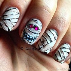 101 Halloween Nail Art Ideas That Are Better Than Your Costume -- love, love this mummy and his pink eyes