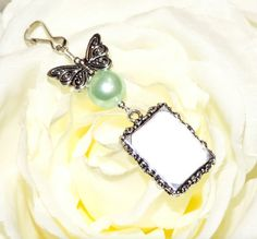 Butterfly and mint green pearl Wedding bouquet by SmilingBlueDog