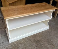 """No assembly required Made at our workshop in Henley-on-Thames   Dimensions Depth – 12"""" (30.5cm) Height – 20"""" (51cm) Top Shelf Height – 6.25″ (16cm) Bottom Shelf Height – 8″ (20cm) Width Across Top – 35"""" (89cm) Shelf Width – 32″ (81cm)   Finish  Fawley Cream with a natural Oak top (Pictured) Black with a dark Oak top"""