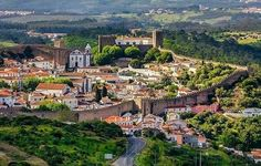 Obidos, Portugal was originally a wedding gift of the Portuguese King Dinis to his bride in 1282. For the next 600 years every Portuguese monarch did the same, offering this lovely village as dowry to the queen. So it is called, Casa das Rainhas, the House of Queens.
