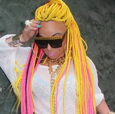 yellow pink box braids with weave