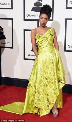 Keen in green: Singer-songwriter Lianne La Havas looked sensational in a lime green asymmetric gown by Vivienne Westwood with a structured top and draped material