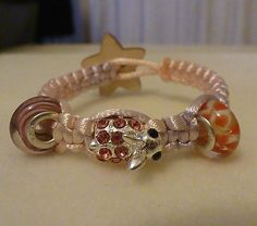 Childs  square knot bracelet with glass european beads and european charm  £5.00