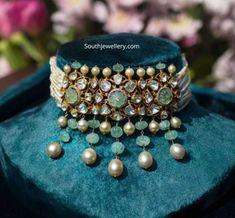 Jewelry OFF! Multi string pearl choker with polki emerald pendant photo Indian Jewelry Earrings, Indian Jewelry Sets, Jewelry Design Earrings, Indian Wedding Jewelry, Jewelery, Necklace Designs, Bridal Jewelry, Indian Bridal, Antique Jewellery Designs