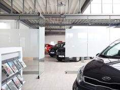 Car dealer, Würzburg (GER) The sliding glass wall HSW Easy Safe with a length of 24 m, divided into 25 wings, as well as another segment of 4 m with 3 wings separates rooms, without really separating. #architecture #design #building #ArchitectureDesign #Smartandsecureaccesssolutions #TrustedAccess #HorizontalSlidingwall #HSW