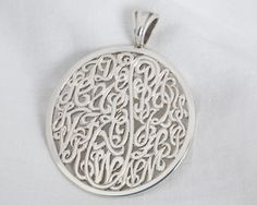 """Custom Hand Engraved and Sawed Out Design By Richard F Neustaedter. The SS Disk Features Every Letter in the Alphabet for a true Universal Monogram. The Disk Measures 1.5"""" in Circumference and Features a Ribbed Bail. www.wowdiamonds-stlouis.com"""