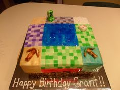 Mine craft cake. Loved creating this! 10 inch square pan. The first layer is chocolate rice crisp. Frost cake and add each element. Each colored square was cut and placed in position. Gold dust for mining was brushed on after frosting wasn't tacky to the touch. graham crackers for sand, rock candy for diamonds. Blue and red gel for water and lava. The Creeper was made from fondant and hand painted; ditto the cake and pick axes.