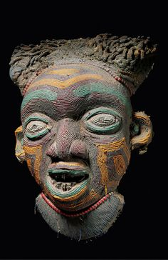 Africa | Mask from the Bamileke people of the Grassfields, Cameroon | Wood, covered in fabric and glass beads.