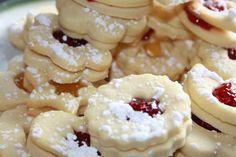 German Spitzbuben Cookies Recipe Desserts with butter, powdered sugar, egg whites, lemon juice, salt, white flour, strawberry jam, apricot jam, powdered sugar