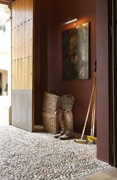 entry door off courtyard, pebbled entryway...