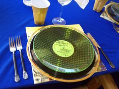 70's Themed Party Tablescape ...Album covers as placemats and the matching vinyl as chargers... 1970's style!
